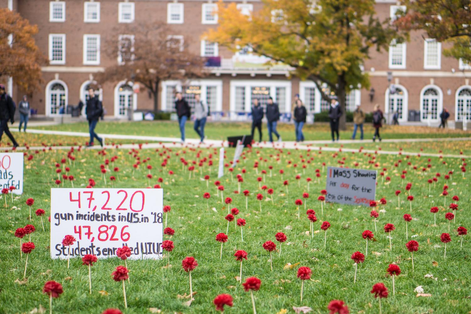 Carnations+and+signs+set+up+by+Amnesty+International+line+the+Main+Quad+to+raise+awareness+for+gun+violence+on+Thursday.+This+sign+compares+the+number+of+gun-related+incidents+this+year+to+the+number+of+students+enrolled+at+the+University.