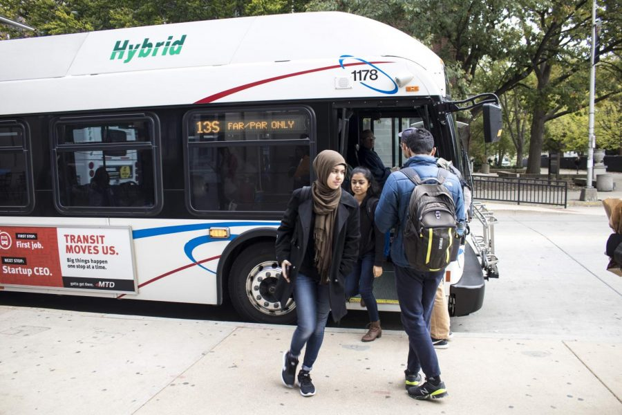 UIUC Students hop aboard the bus to take them home or to classes at  the most central bus stop location,Transit Plaza, located on Wright Street.