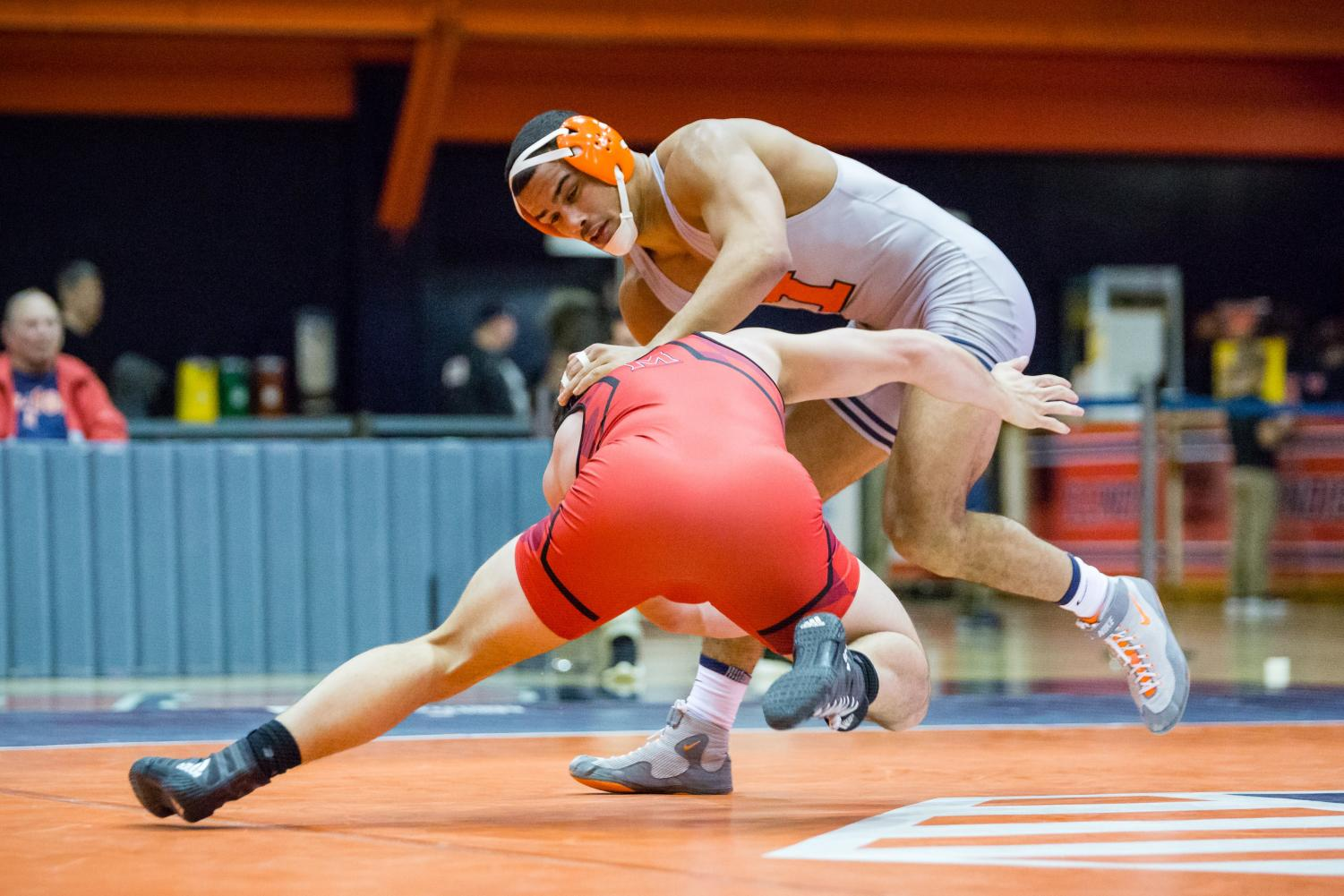 Illinois' Emery Parker wrestles with Maryland's Niko Capello in the 184 pound weight class during the meet at Huff Hall on Sunday, Jan. 28, 2018. The Illini won 25-18.