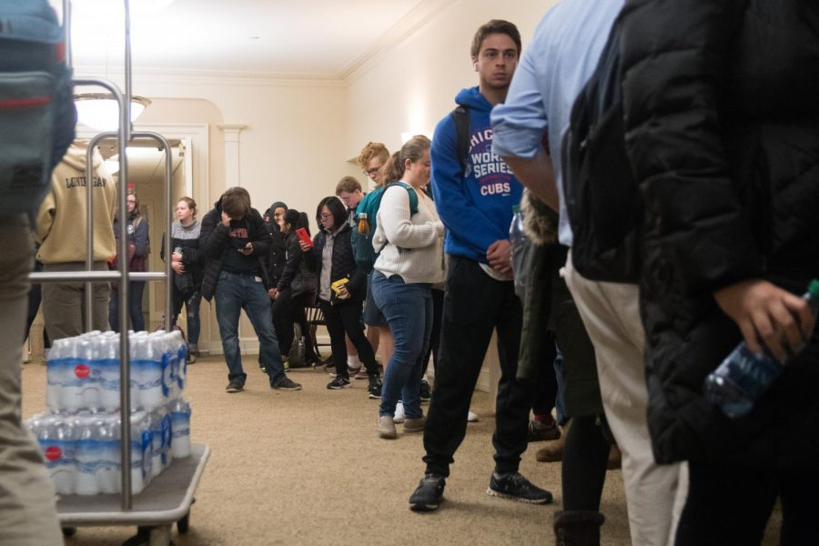 Hundreds of University students line up at the Illini Union to vote early.