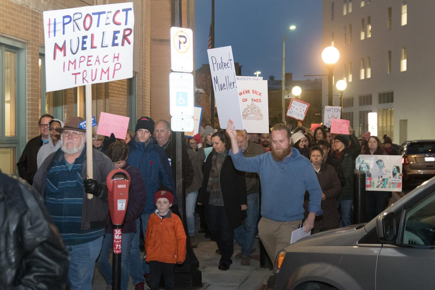 Protesters march through downtown Champaign on Thursday in response to President Trump's decision to replace Rod Rosenstein with Acting Attorney General Matt Whitaker as the head of the Mueller probe.  The Nobody is Above the Law protest was previously organized so that if President Trump were to replace the oversight of the special counsel, a rapid response series of protests would take place the next day.