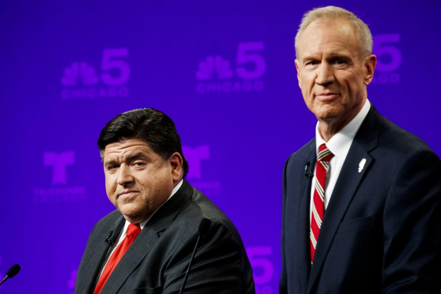 Candidates+for+governor%2C+Bruce+Rauner+and+J.B.+Pritzker+pose+mid+debate.+As+election+day+approaches%2C+economic+policy+will+be+a+high-priority+issue+facing+the+people+of+Illinois.+