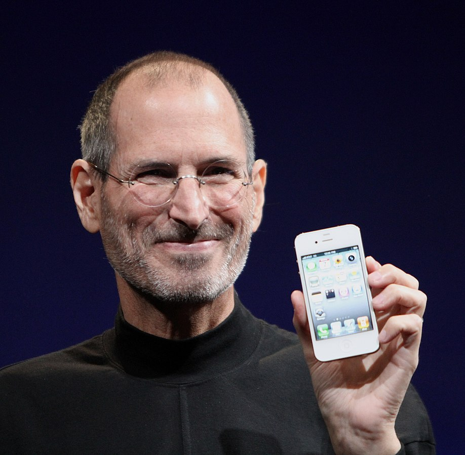 Steve Jobs smiles while showcasing the Apple product, the iPhone. Jobs is among many who change the world through the power of creativity.