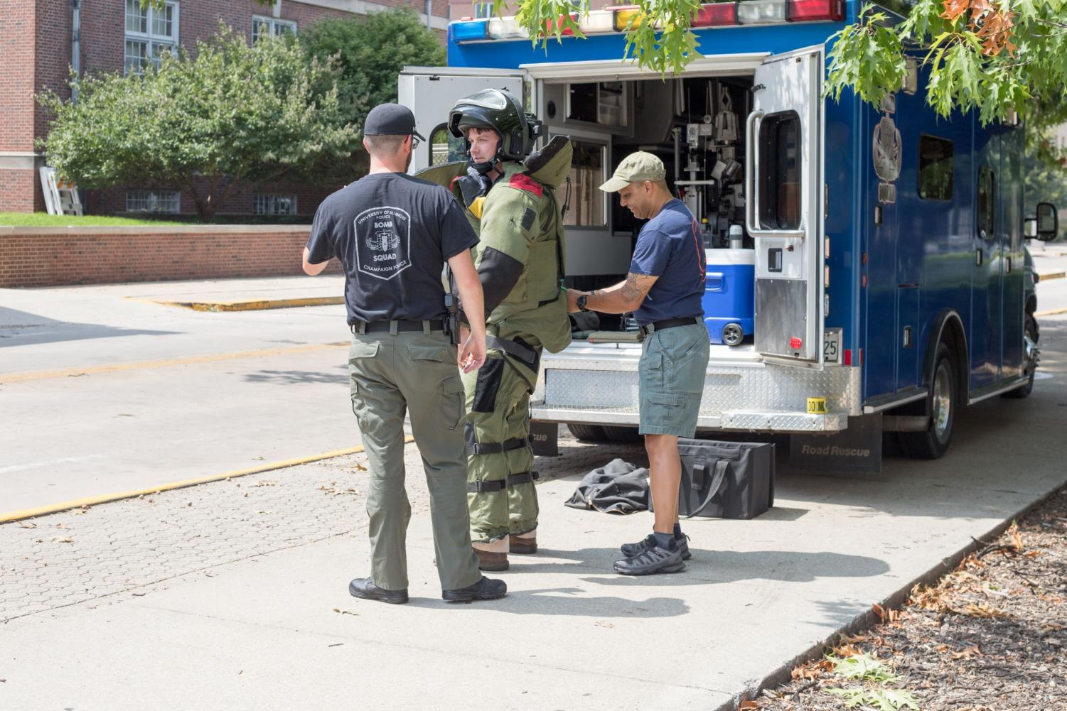 A member of the bomb squad suits up to address a suspicious package left on the 1100 block of Sixth Street on Aug. 26.