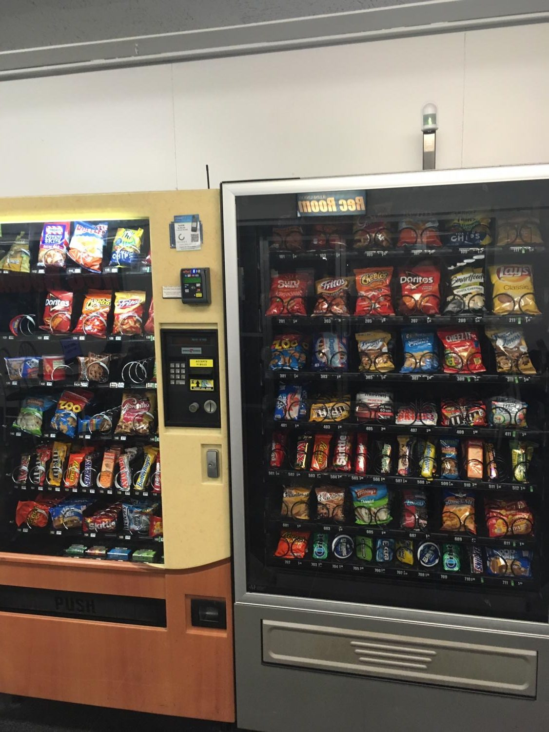 Vending machines stocked with energy drinks, sugary sodas and convenient snacks at the Illini Union. While students are busy with finals, it is important to maintain healthy habits, including a nutritious diet and exercise.