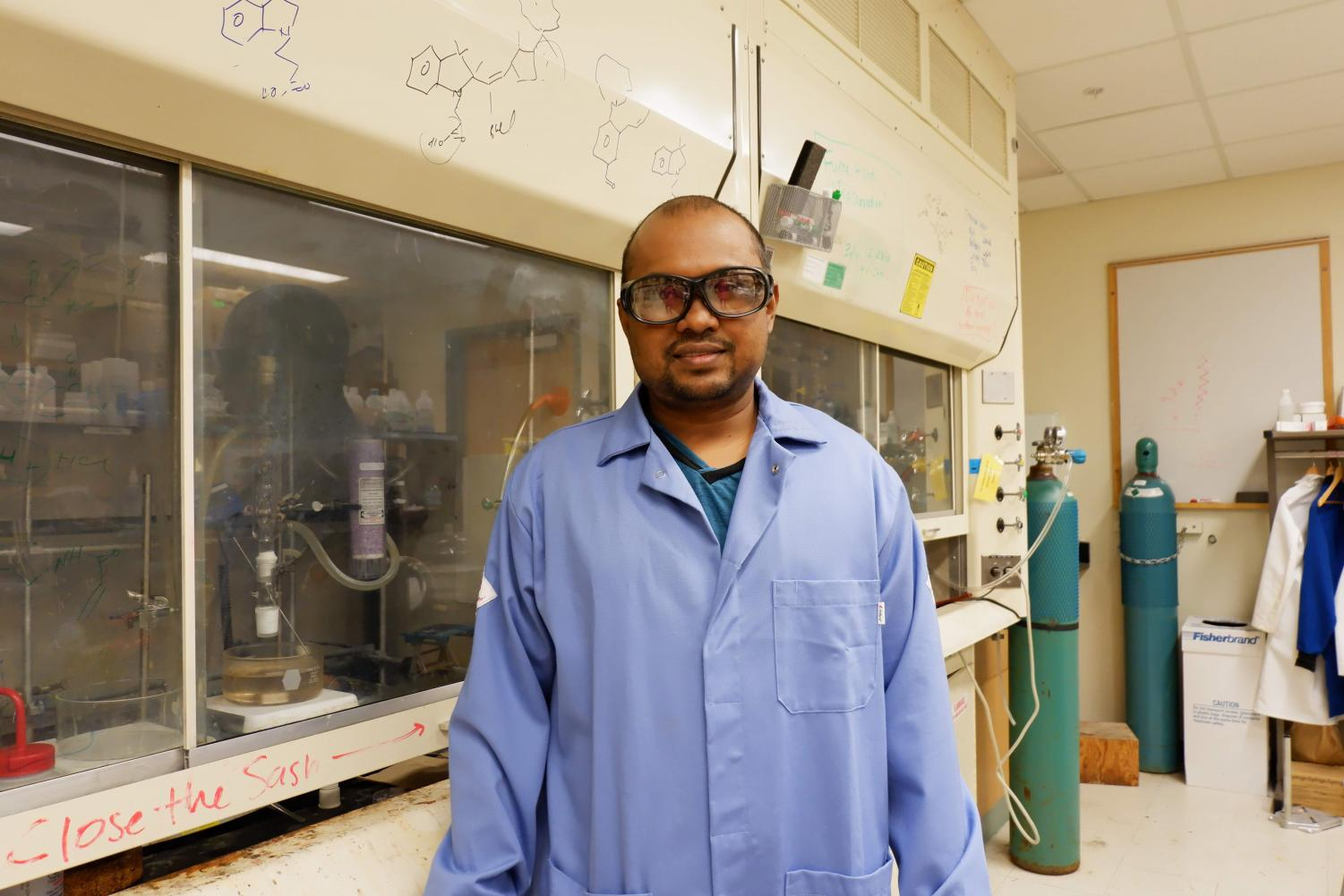 Mohammad Amdad Ali in his lab at the Beckman Institute on Monday. Ali is a postdoctoral researcher working on the sensor.