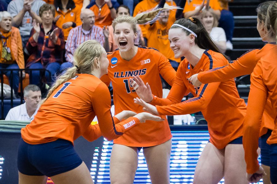 Illinois+middle+blocker+Ashlyn+Fleming+%2812%29+celebrates+with+setter+Jordyn+Poulter+%281%29+after+scoring+a+point+during+the+match+against+Marquette+in+the+third+round+of+the+NCAA+tournament+at+Huff+Hall+on+Friday%2C+Dec.+7%2C+2018.+The+Illini+won+3-0.