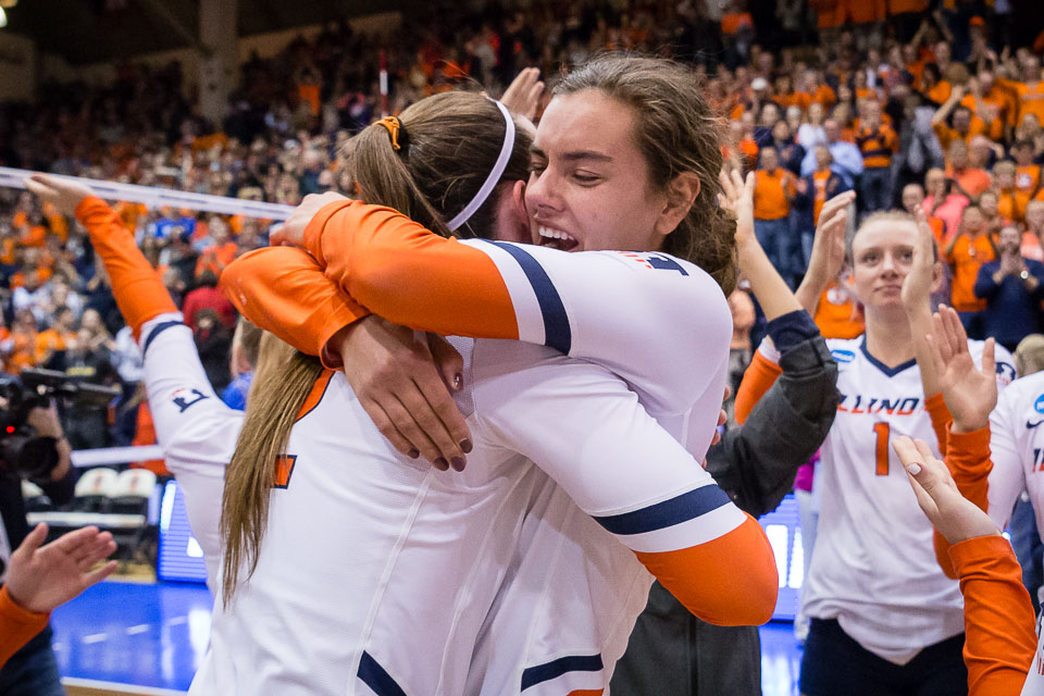 Illinois outside hitter Jacqueline Quade (right) hugs middle blocker Ashlyn Fleming (left) after the match against Wisconsin in the Elite Eight of the NCAA tournament at Huff Hall on Saturday, Dec. 8, 2018. The Illini won 3-1.