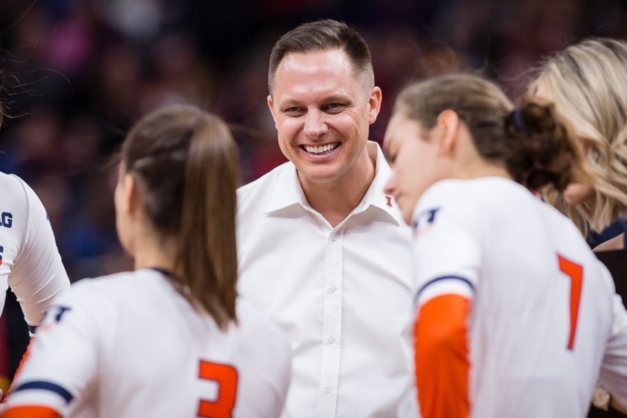 Illinois head coach Chris Tamas smiles during a timeout in the match against Nebraska in the Final Four of the NCAA tournament at the Target Center on Thursday, Dec. 13. The Illini look forward to the 2019 season in anticipation of the talent recruits like Ellie Holzman will bring to the table.