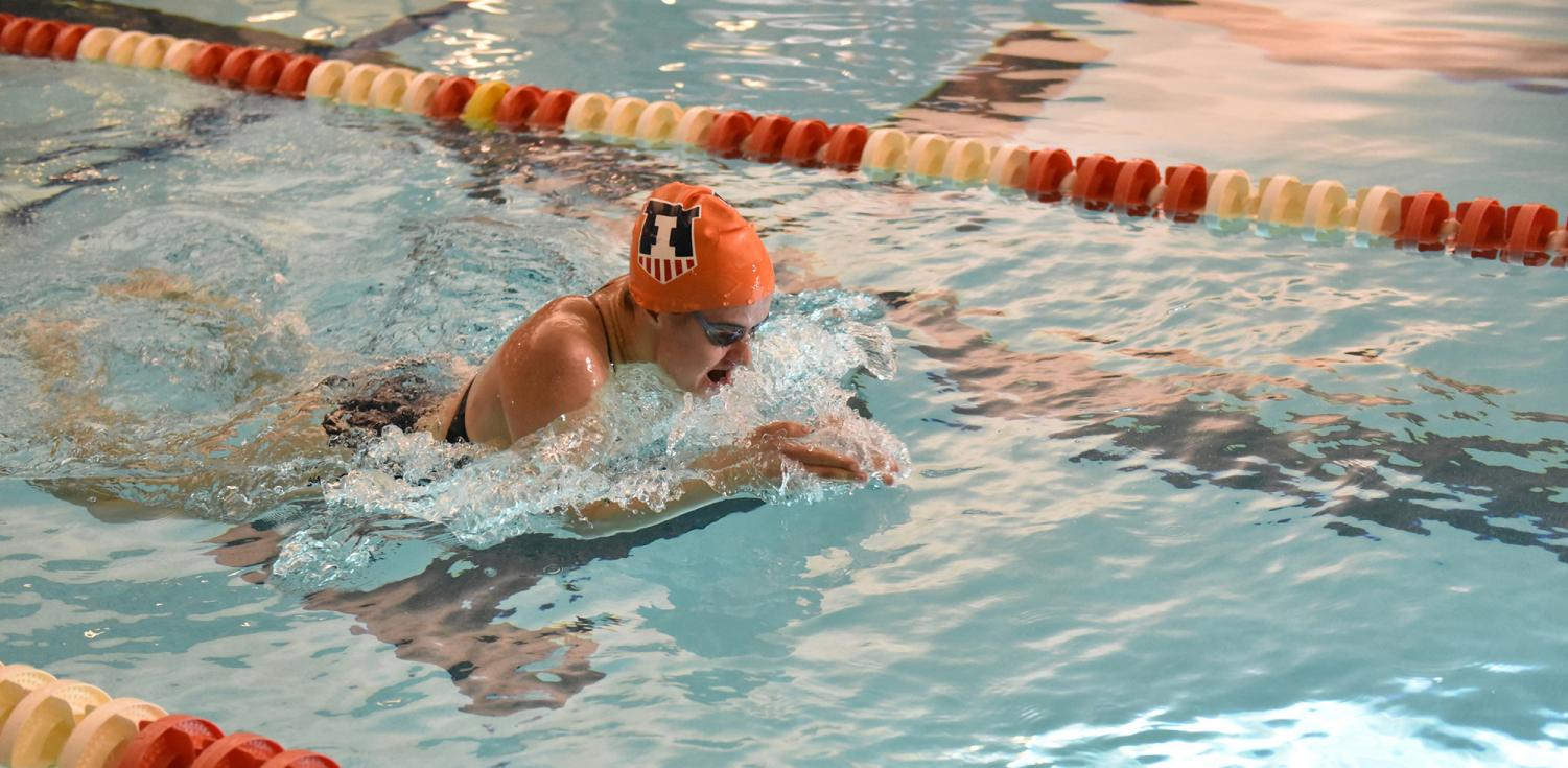Gabriele Serniute competes for the swimming and diving team in a breaststroke race. The senior is putting together one of her best seasons so far.