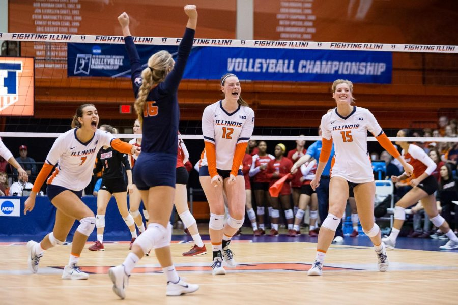 The+Illini+celebrate+after+scoring+a+point+during+the+match+against+the+Cardinals+in+the+second+round+of+the+NCAA+Tournament+at+Huff+Hall+on+Saturday.