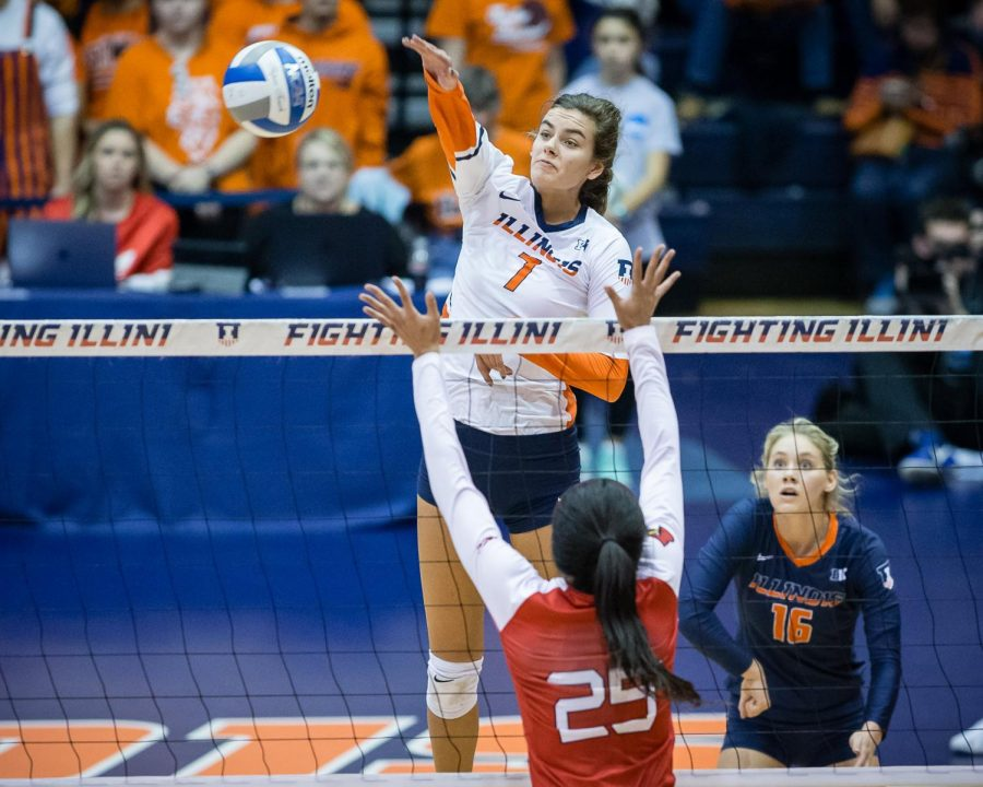 Illinois outside hitter Jacqueline Quade spikes the ball from the back row during the match against Louisville in the second round of the NCAA tournament at Huff Hall on Saturday. The Illini won 3-1.