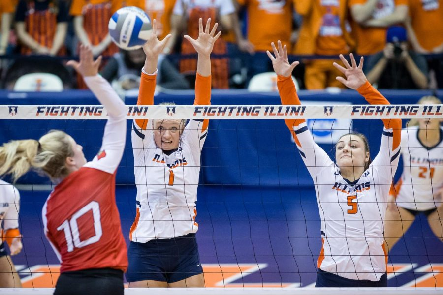 Illinois+setter+Jordyn+Poulter%2C+left%2C+and+middle+blocker+Ali+Bastianelli%2C+right%2C+try+to+block+the+ball+during+the+match+against+Louisville+in+the+second+round+of+the+NCAA+Tournament+at+Huff+Hall+on+Saturday.+The+Illini+won+3-1.