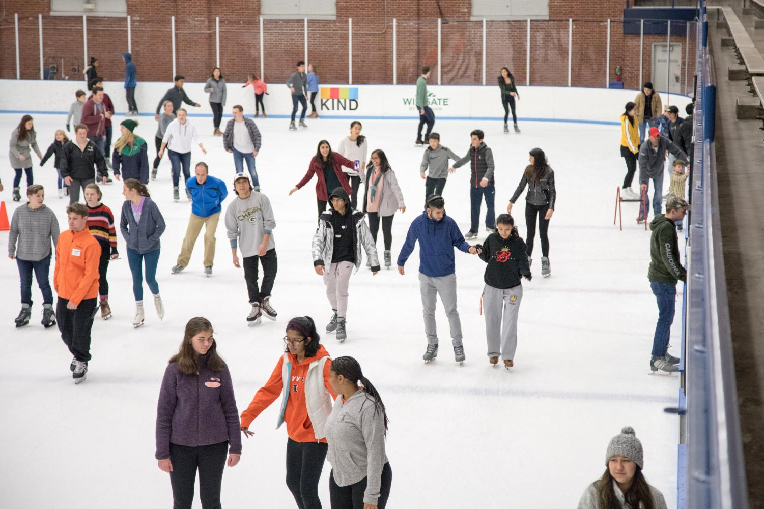 Students ice skate at the University Ice Arena on Saturday.