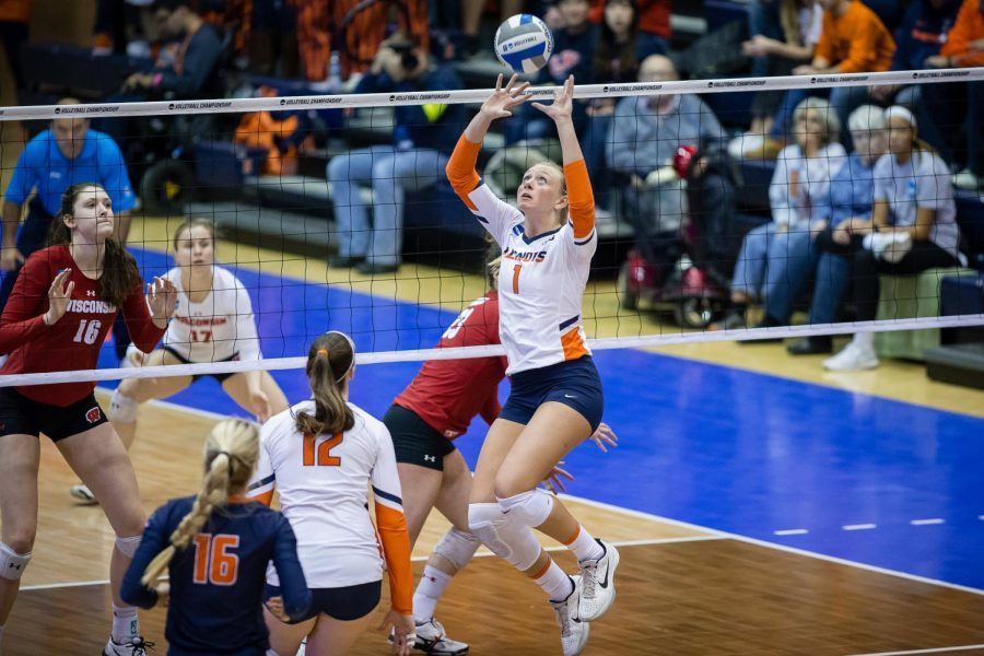 Illinois+setter+Jordyn+Poulter+sets+the+ball+during+the+match+against+Wisconsin+in+the+Elite+Eight+of+the+NCAA+tournament+at+Huff+Hall+on+Saturday.+The+Illini+won+3-1.