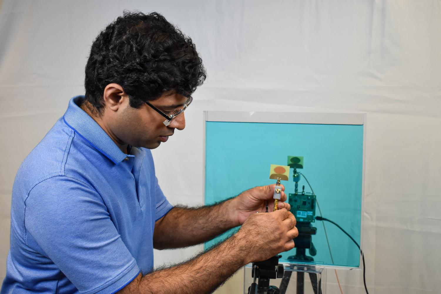 Ashutosh Dhekne, graduate student in computer science, came up with the idea of innovating a device that can identify liquids, which could be especially useful in airports. He and a team have created the device and are further developing it.