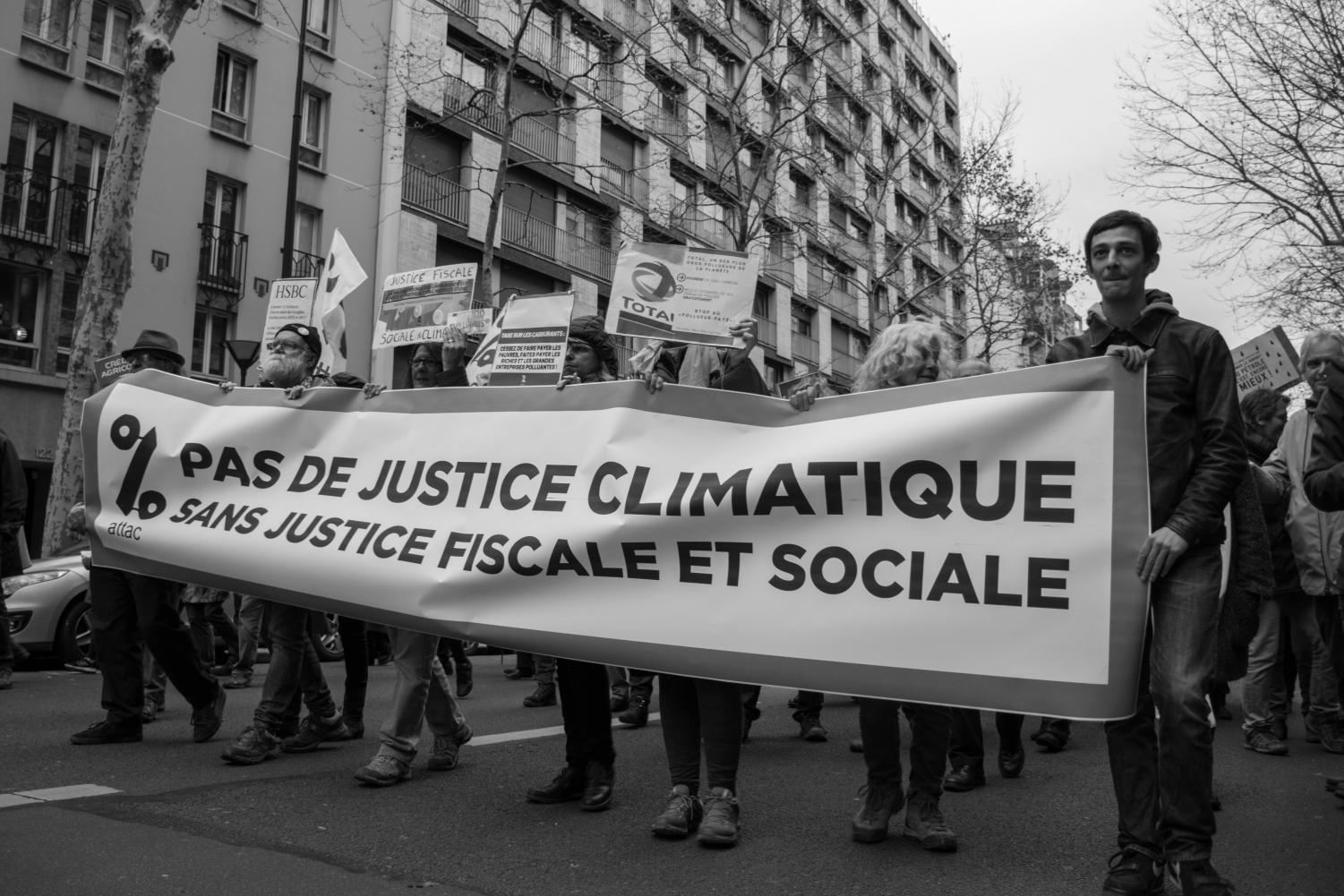 Protesters march against climate change in Paris on Dec. 8. Columnist Agastya argues the march demonstrates much more than environmental awareness.
