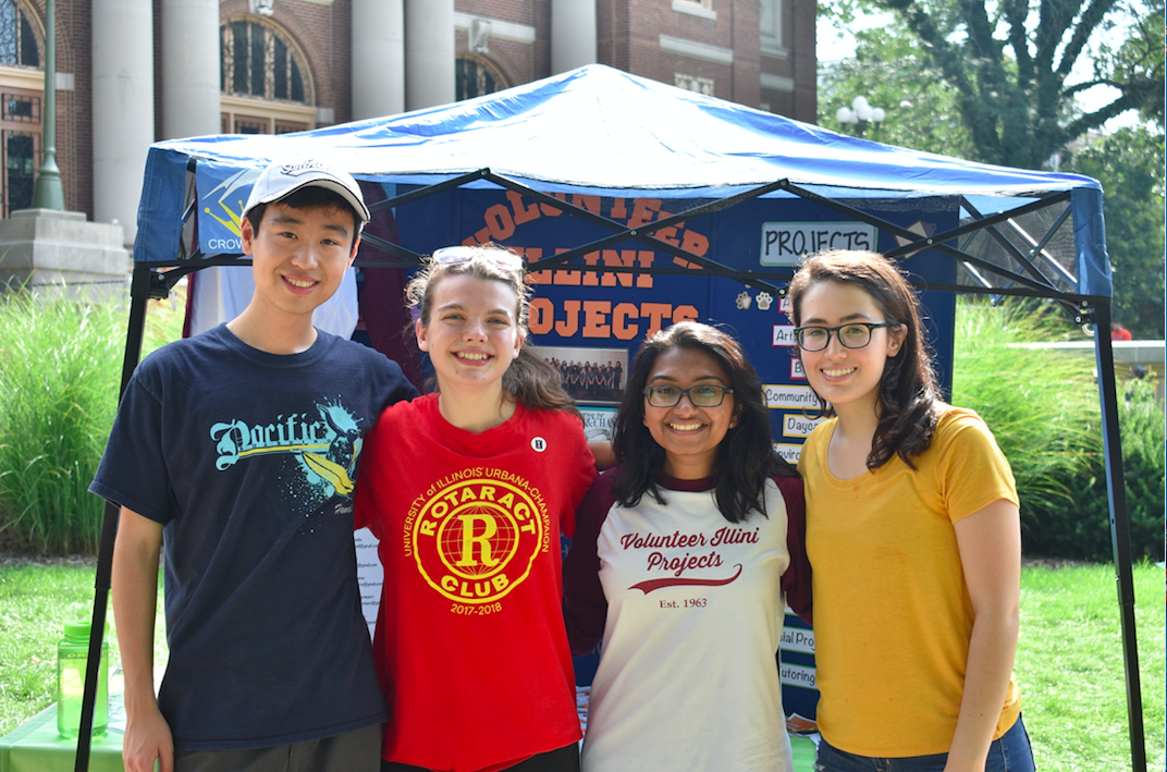 David Cao, Marley Majetic, Sara Babo and Adrianna Velasco, members of the student organization Volunteer Illini Projects, pose for a photo in front of their promotional booth on last year's Quad Day.