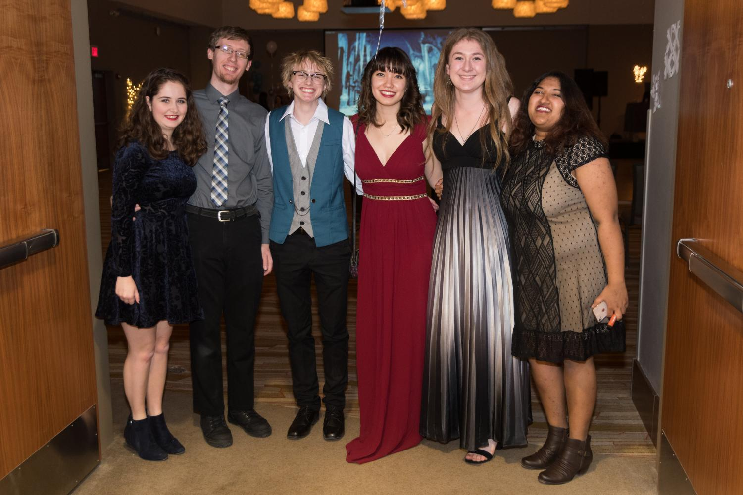 Yule Ball attendees (from left to right) Becca Sullivan and Aryk Sullivan pose with students Kai Wiest, Holly Miller, Clair Markuson and Apurva Chakravorty, who are working the door. The third annual Yule Ball took place at the I Hotel Conference Center on Jan. 19.