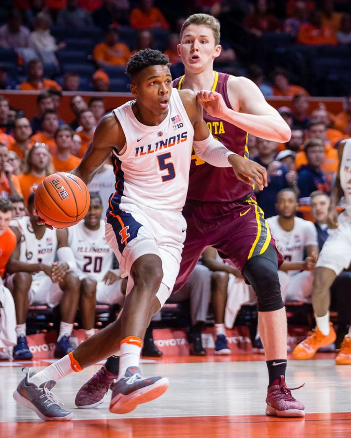 Illinois+guard+Tevian+Jones+dribbles+around+his+defender+during+the+game+against+Minnesota+at+the+State+Farm+Center+on+Jan.+16.+The+Illini+won+95-68.