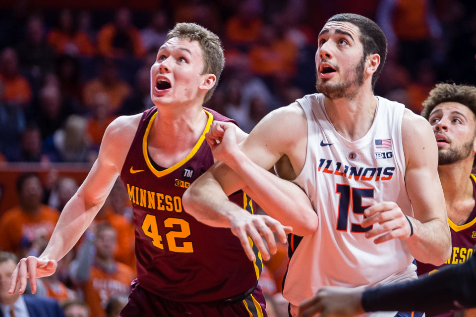 Illinois forward Giorgi Bezhanishvili (15) fights for position to rebound the ball during the game against Minnesota at State Farm Center on Wednesday, Jan. 16, 2019.