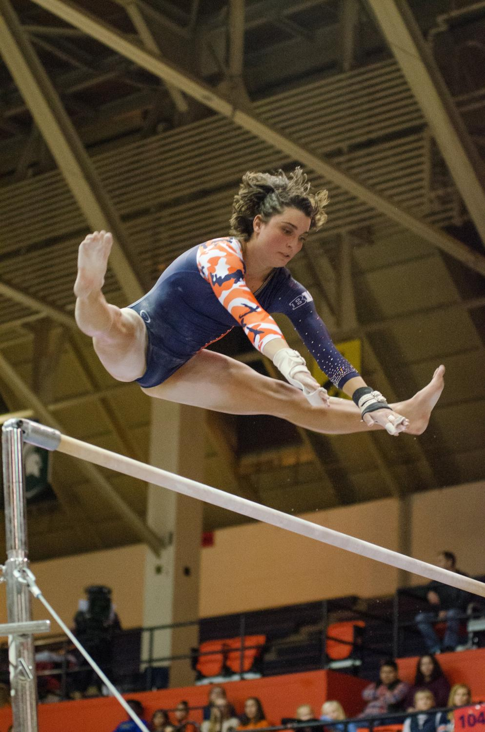 Rae Balthazor performs her bars routine during Illinois' meet against Michigan on Jan. 19, 2018. Illinois lost to Michigan 194.325 to 194.975.