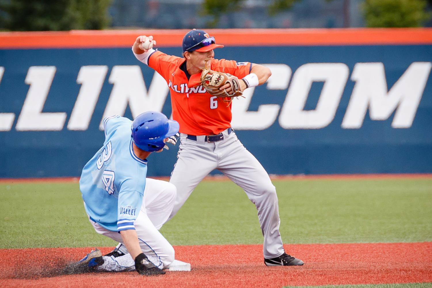 Illinois second baseman Michael Massey throws the ball to first for a double play during the exhibition game against Indiana State at Illinois Field on Sept. 22. The Illini tied 5-5. Massey was placed in the top-10 Big Ten Division I MLB Prospect list with several other Illini players.