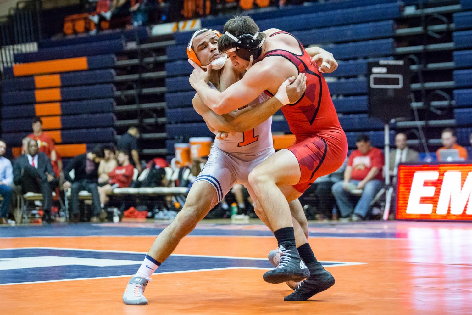 Illinois' Emery Parker wrestles with Maryland's Niko Capello in the 184-pound weight class during the meet at Huff Hall on Jan. 28. The Illini won 25-18.