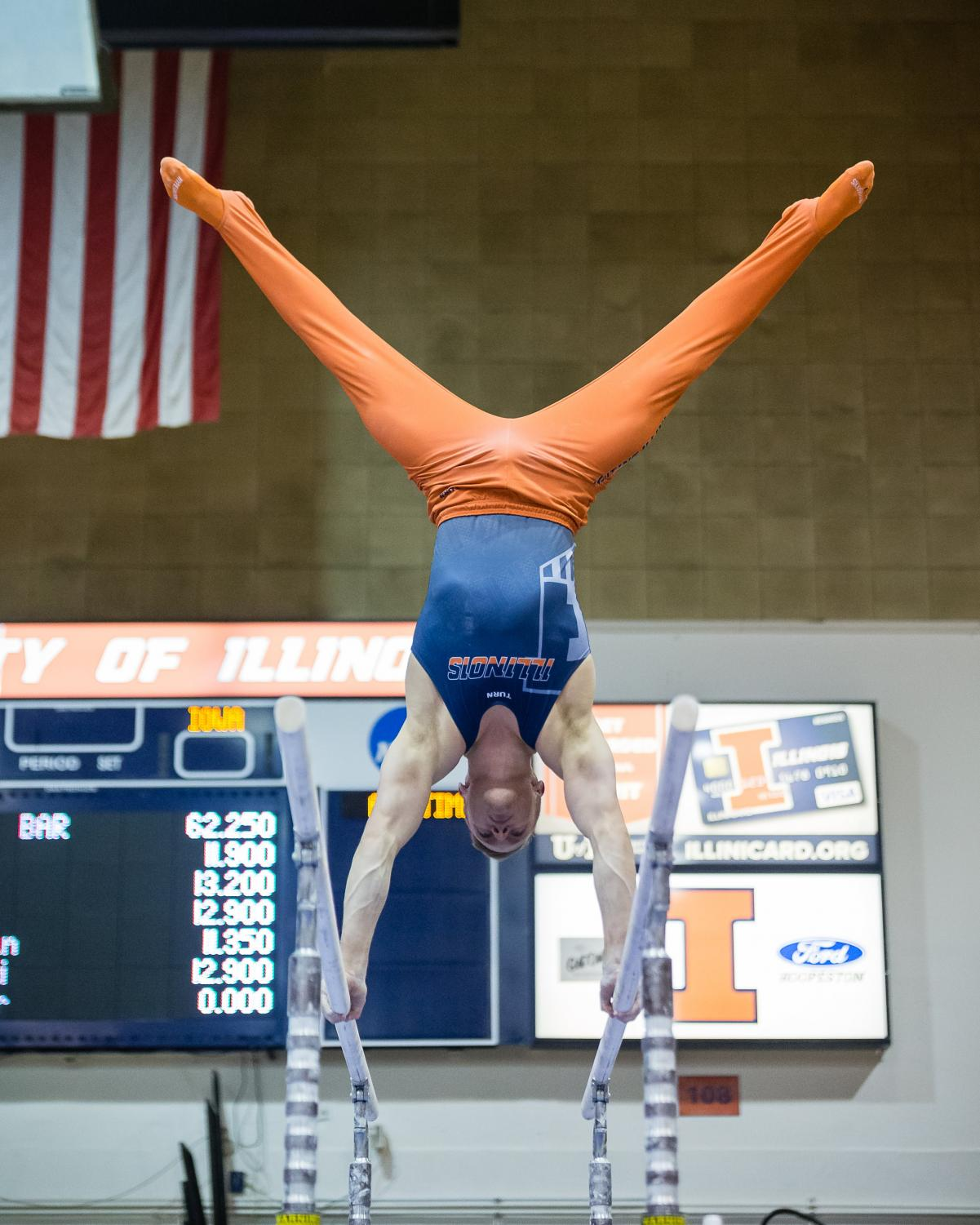 Illinois' Johnny Jacobson performs on the parallel bars during the meet against Iowa at Huff Hall on Saturday. The Illini won 410.450-398.800.