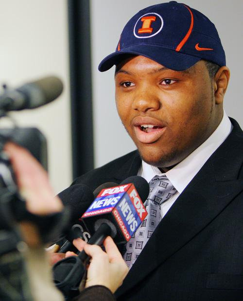 Jeffrey Allen, a student from King College Prep, signed his letter of intent with the University of Illinois today during the Football National Letter of Intent Signing Day Program in Chicago, Feb. 6, 2008. Three players, including Allen, from Chicago Public Schools signed with Illinois.