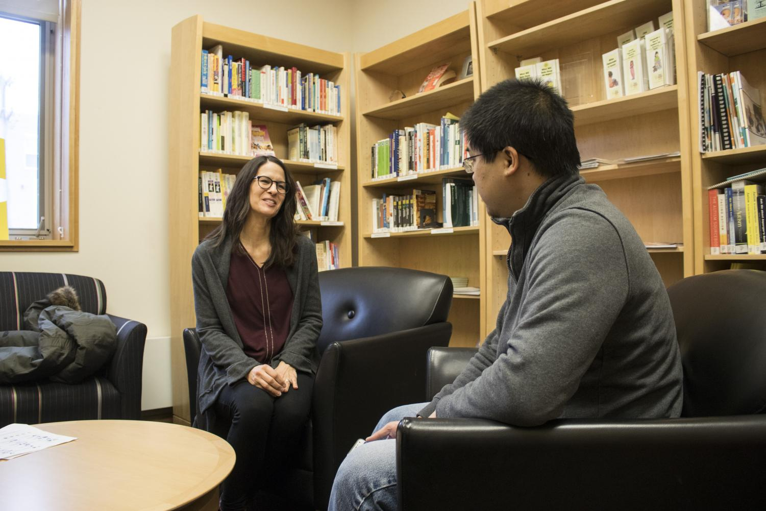 Jeanne Kramer (left), an employee of the new Microsoft Lighthouse Initiative, speaks with participant, Ethan Chew (right), at Christopher Hall.