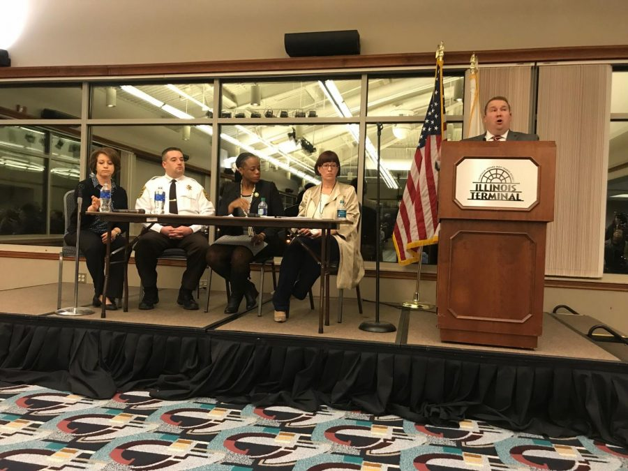 "Illinois State Sen. Scott Bennett (far right) introduces the legislative panel during a town hall meeting ""C-U Talks Marijuana Legalization"" on Feb. 18. The panel is comprised of (left to right) Champaign County State's Attorney Julia Rietz, Champaign County Sheriff Dustin Heuerman, State Rep. Carol Ammons and Illinois State Sen. Heather Steans. The panel took questions and addressed concerns from the audience at the prospect of recreational marijuana legalization in Illinois."