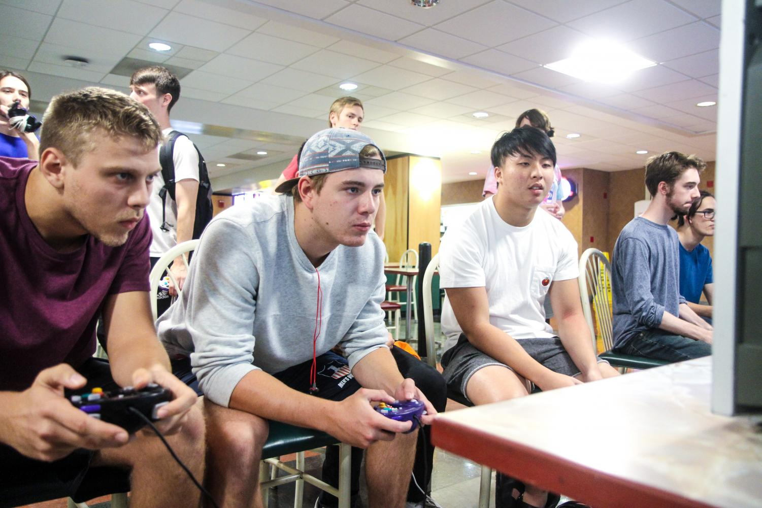 Students Wesley Blodig, Kyle Biedron and Bernard Chan play Super Smash Brothers Melee for the Nintendo Gamecube in the basement of the Illini Union on Oct. 5.