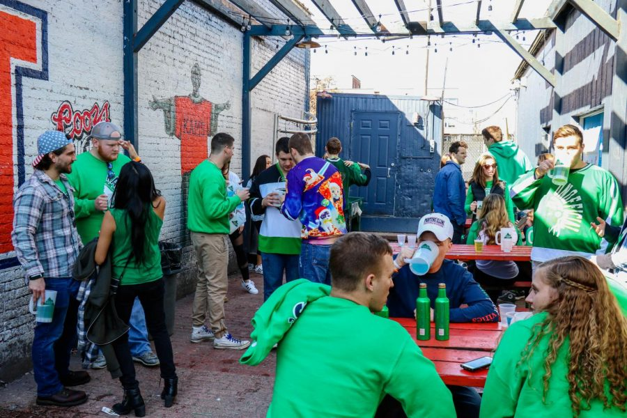 Patrons of KAM's hang out in the beer garden during Unofficial on March 3, 2017.