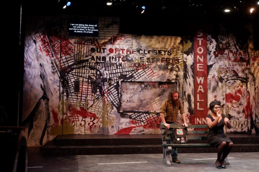 """Acting students Brandon Burditt (right) and Andrew Morrill (left) perform in """"Hit the Wall"""" at the Studio Theatre at the Krannert Center for the Performing Arts on Saturday. Supertitles — subtitles above the stage — enhance audience experience."""