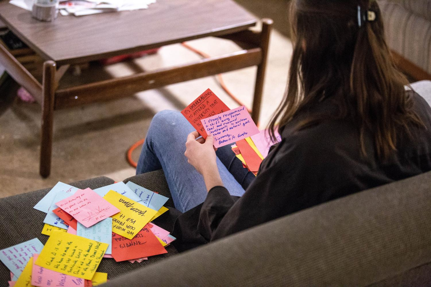 AnnaMae Dziallo, senior in ACES and president of Beyond Coal, sorts through letters from supportive students on Friday. Beyond Coal is an RSO at the forefront of the coal divestment movement, advocating for renewable resources such as solar, hydrological and geothermal energies.