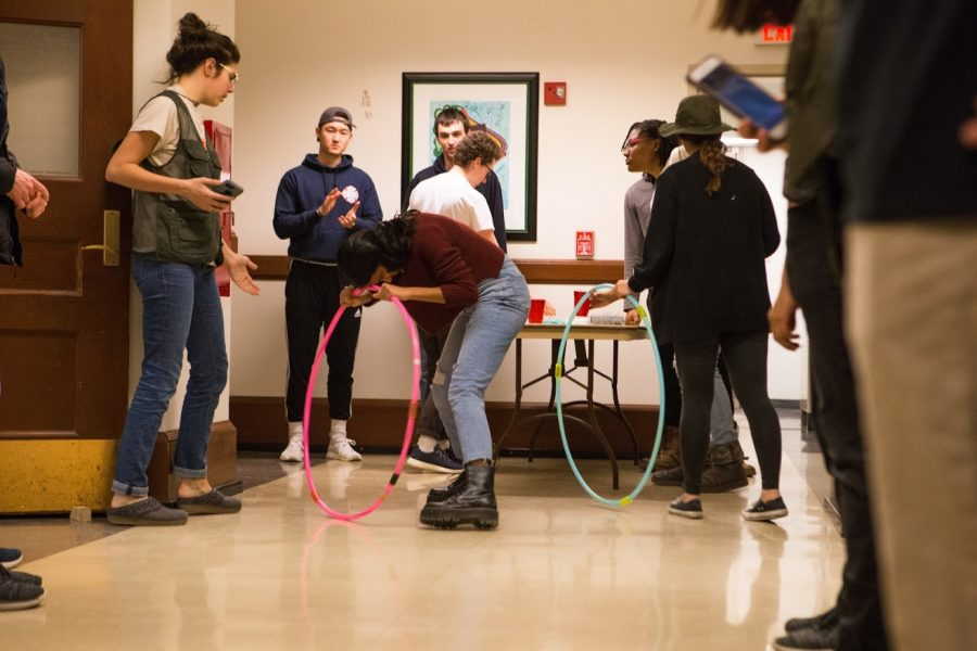 Uma Krishnan, a junior studying Computer Science + math, spins around a hula hoop in the second part of Eweek's Dizzy Bone relay race.
