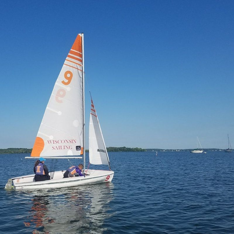 The Illinois Sailing Team take out its sailboat out on the water. The team participates in sailing races throughout the year, but the members can also sail for personal enjoyment