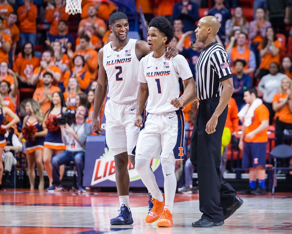 Illinois guard Trent Frazier (1) celebrates with forward Kipper Nichols (2) after hitting a three during the game against Nebraska at the State Farm Center on Saturday. The Illini won 71-64.