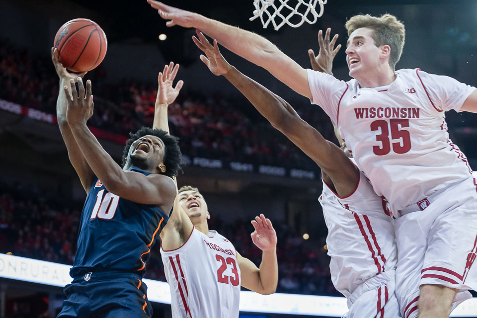Illinois guard Andres Feliz attempts to put up a layup during the game against Wisconsin at the Kohl Center in Madison, Wisconsin, on Monday. The Illini lost 58-64, snapping the team's longest win streak in the Brad Underwood era.