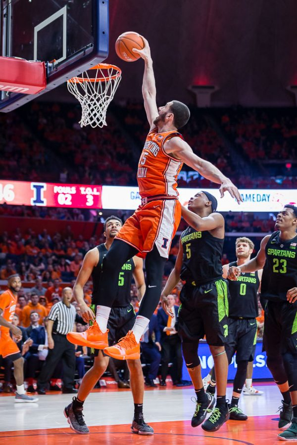 Illinois+forward+Giorgi+Bezhanishvili+rises+up+to+dunk+the+ball+during+the+game+against+Michigan+State+at+the+State+Farm+Center+on+Feb.+5.+The+Illini+won+79-74+and+are+looking+to+continue+their+win+streak+against+the+Buckeyes+on+Thursday.+
