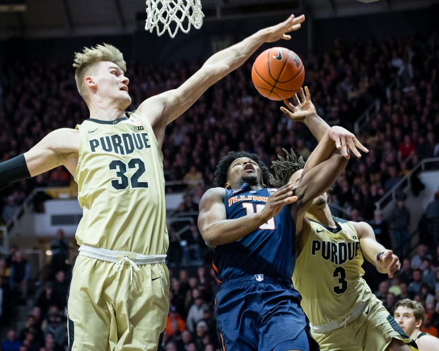 Illinois guard Andres Feliz (10) gets blocked by Purdue center Matt Haarms (32) during the game against Purdue at Mackey Arena on Wednesday, Feb. 27, 2019. The Illini lost 73-56.