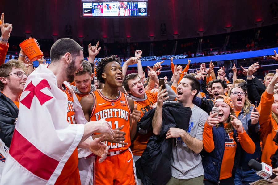 Students+celebrate+with+guard+Ayo+Dosunmu+%2811%29+and+forward+Giorgi+Bezhanishvili+%2815%29+after+their+post-game+interview+after+the+game+against+Michigan+State+at+State+Farm+Center+on+Tuesday%2C+Feb.+5%2C+2019.+The+Illini+defeat+the+Spartans+79-74.