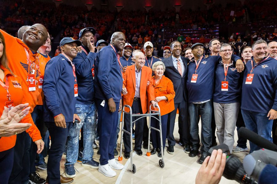 Members of the 1989 Flyin' Illini team gather around coach Lou Henson. The team advanced to the 1989 Final Four in Seattle before losing to eventual champion Michigan.