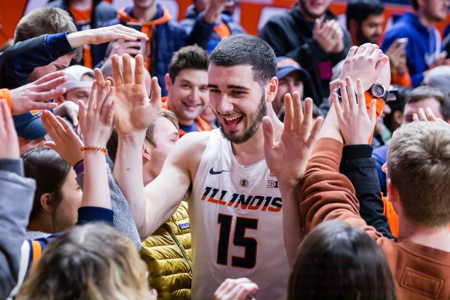 Illinois forward Giorgi Bezhanishvili (15) high fives fans after the game against Rutgers at State Farm Center on Saturday, Feb. 9, 2019. The Illini won in overtime, 99-94.