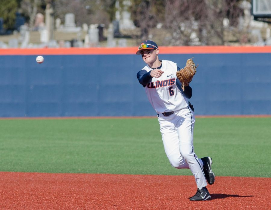 Michael Massey throws the ball to first base during Illinois' game against Milwaukee on March 14. Massey is heading into this season as the No. 2 Big Ten MLB draft prospect.