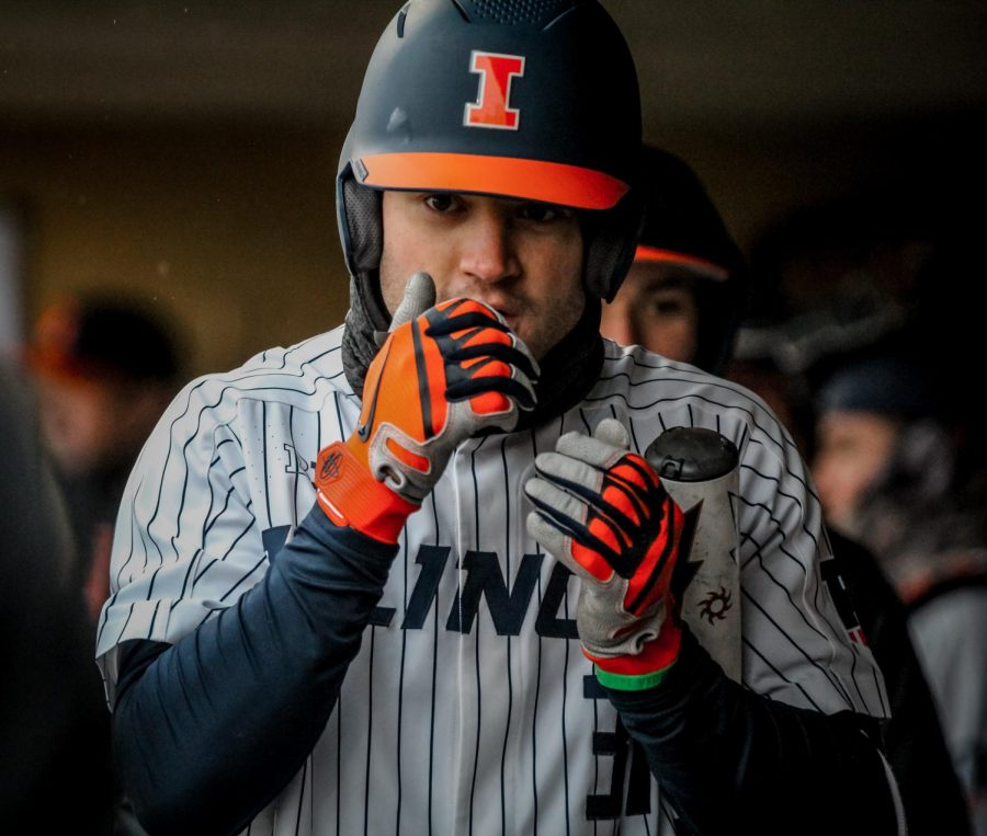 Zac+Taylor+walks+in+the+dugout+during+the+opening+weekend+series+at+Wake+Forest+in+Winston-Salem%2C+North+Carolina%2C+on+Saturday.+The+Illini+went+on+to+sweep+the+opening+series+behind+a+strong+hitting+performance+by+Taylor.