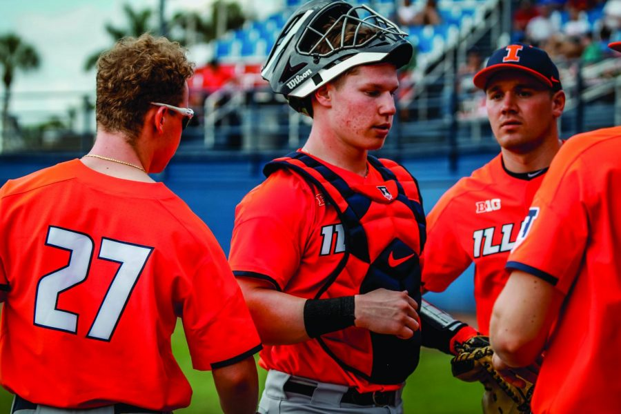Freshman catcher Jacob Campbell walks back to the dugout during the Illini's tournament in Boca Raton, Florida. Campbell decided to attend the University despite being drafted by the Chicago Cubs in the 2018 MLB Draft.