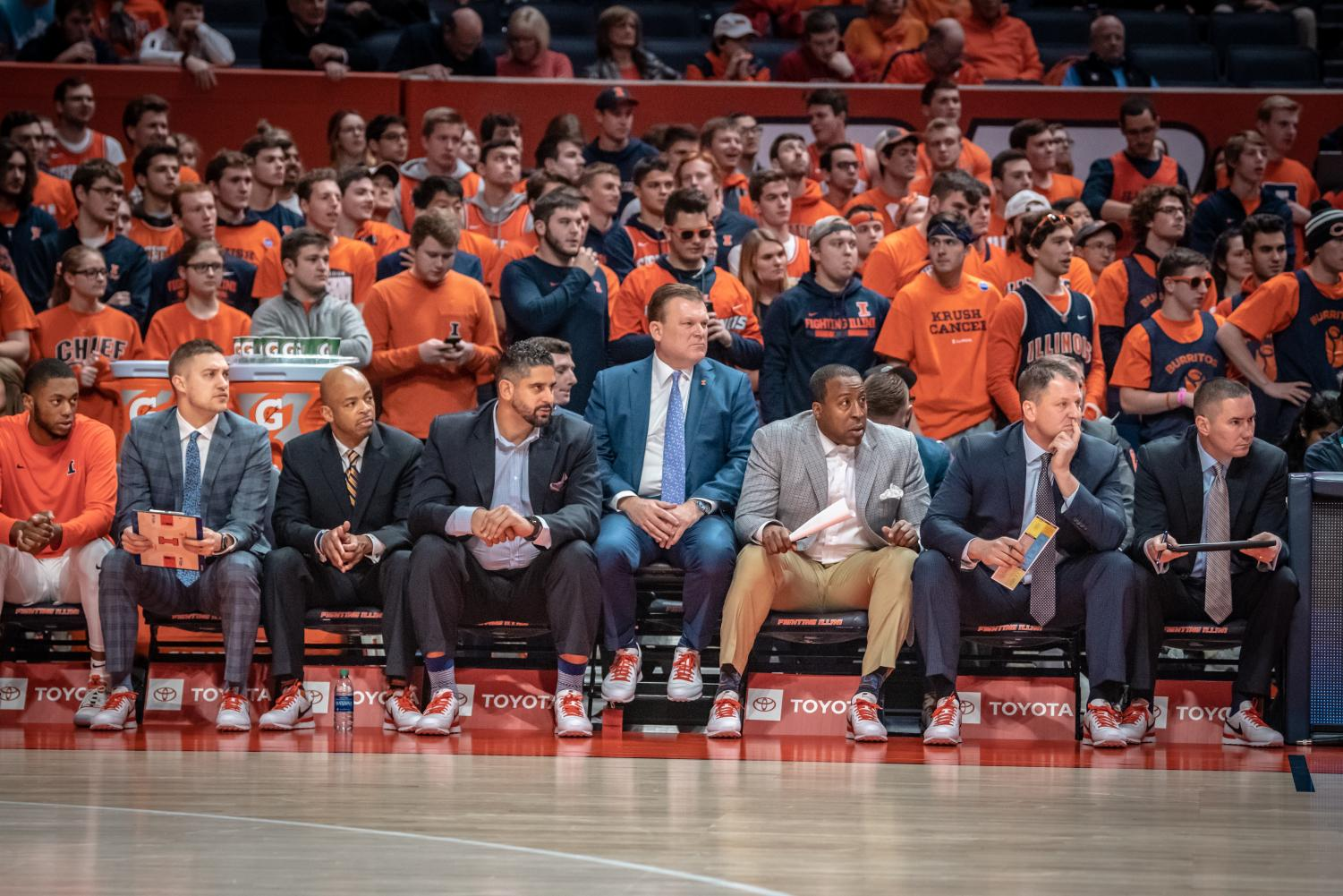 Head coach Brad Underwood and other assistant coaches wear sneakers with their formal attire to promote cancer research and awareness on Jan. 23. The Coaches vs. Cancer 3-Point Challenge was created by the American Cancer Society and the National Association of Basketball Coaches.