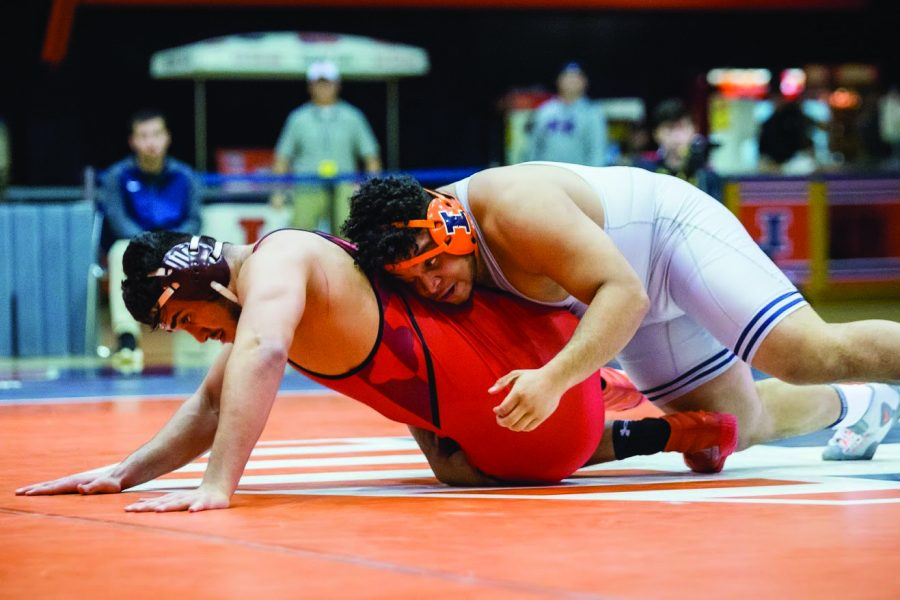 Illinois%E2%80%99+Deuce+Rachal+wrestles+with+Maryland%E2%80%99s+Youssif+Hemida+in+the+285-pound+weight+class+during+the+meet+at+Huff+Hall+on+Jan.+28.+The+Illini+won+25-18.